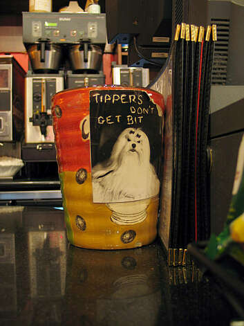 Tip jar from People's Cafe in the Upper Haight. Photo: Jillian Welsh