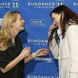 "Director Jennifer Siebel Newsom, left, greets actress Geena Davis at the premiere of ""Miss Representation"" during the 2011 Sundance Film Festival in Park City, Utah, on Saturday, Jan. 22, 2011."
