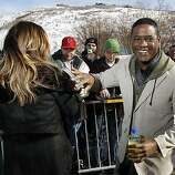 """Actor Blair Underwood, right, taps fellow cast member Rita Wilson, left, on the shoulder after signing autographs for fans at the premiere of """"Homework"""" during the 2011 Sundance Film Festival in Park City, Utah on Sunday, Jan. 23, 2011."""