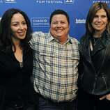 """Chaz Bono, center, subject of the Oprah Winfrey Network documentary film """"Becoming Chaz,"""" poses with his girlfriend Jennifer Elia, left, and his step-mother Mary Bono Mack at the premiere of the film at the 2011 Sundance Film Festival in Park City, Utah,Sunday, Jan. 23, 2011."""