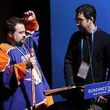 """Director Kevin Smith, left, performs a mock auction of his film """"Red State"""" with producer Jonathan Gordon, right, while addressing the audience after its during the 2011 Sundance Film Festival in Park City, Utah on Sunday, Jan. 23, 2011."""