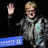 """Robert Redford, founder and president of the Sundance Institute, waves to the crowd at the premiere of the film """"Sing Your Song"""" on the opening night of the 2011 Sundance Film Festival in Park City, Utah, Thursday, Jan. 20, 2011."""