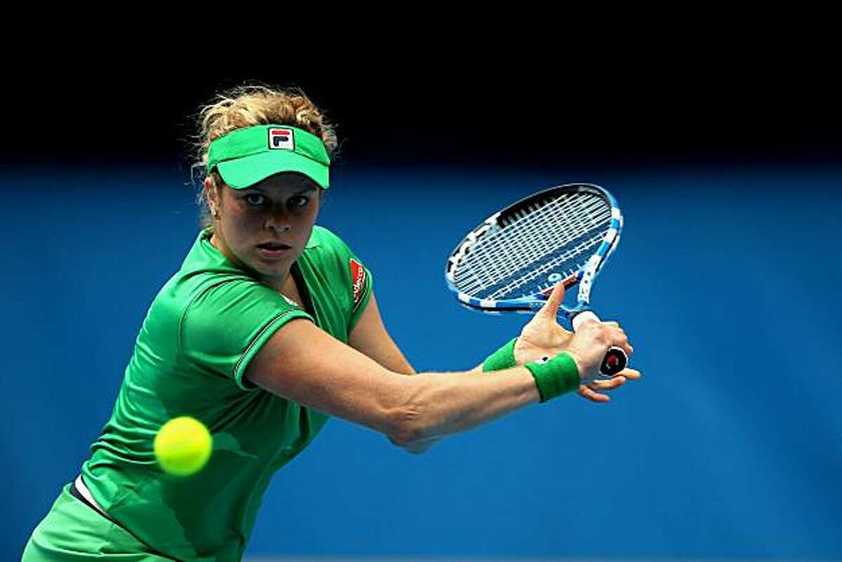 MELBOURNE, AUSTRALIA - JANUARY 26: Kim Clijsters of Belgium plays a backhand in her quarterfinal match against Agnieszka Radwanska of Poland during day ten of the 2011 Australian Open at Melbourne Park on January 26, 2011 in Melbourne, Australia.