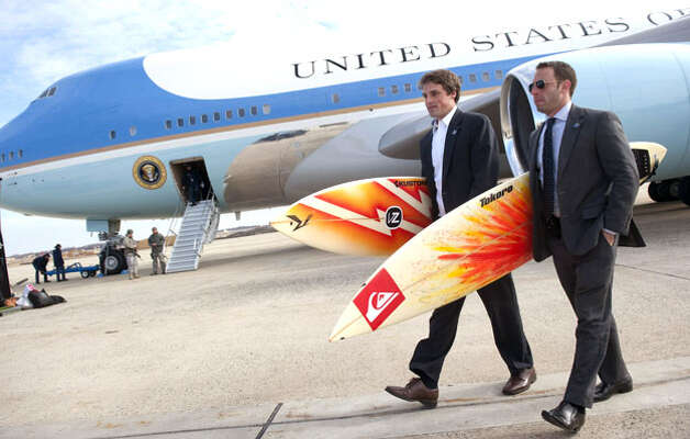 White House staffers Ben Finkenbinder and Nick Shapiro carry surfboards as they walk away from Air Force One after arriving with President Barack Obama at Andrews Air Force Base in Maryland, Jan. 4, 2011, following Obama's two-week vacation with his family in Hawaii. Photo: Saul Loeb, AFP / Getty Images