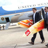 White House staffers Ben Finkenbinder and Nick Shapiro carry surfboards as they walk away from Air Force One after arriving with President Barack Obama at Andrews Air Force Base in Maryland, Jan. 4, 2011, following Obama's two-week vacation with his family in Hawaii.