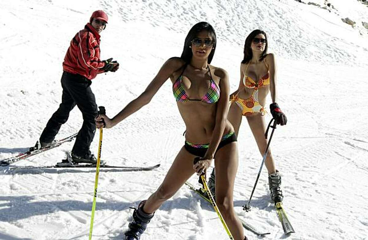 Miss World Top Model 2010 Venezuela's Luna Ramos (L) and Miss Venezuela 2007 Adriana Pena pause in swimwears at the Lebanese ski resort of Kfardebian (known as Faray) northeast of Beirut on January 12, 2011. AFP PHOTO/JOSEPH EID (Photo credit should read JOSEPH EID/AFP/Getty Images)