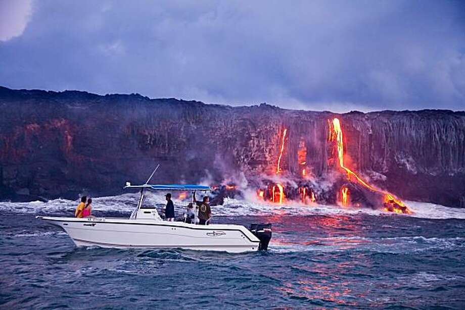 Boat tours to see lava flowing into the ocean depart from the Isaac Hale Beach Park 21 miles southwest of Hilo. Photo: Tor Johnson, HTA