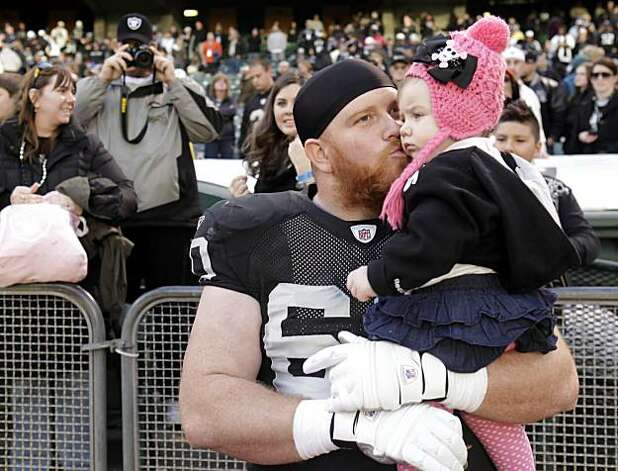 Commitment to Excellent Fatherhood - 4 p.m. - Oakland.   Raiders's Daniel Loper gives his daughter, Savannah Loper a kiss after the game on Sunday.  Camera settings: Canon 5D MkII, ISO 1000, 1/640, f4.0,  35 mm lens Photo: Carlos Avila Gonzalez, The Chronicle