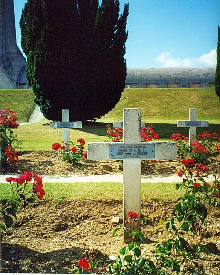 Red roses decorate gravestones in a military cemetery near Verdun, one of World War I's deadliest battlefields. Photo: Abe Bringolf
