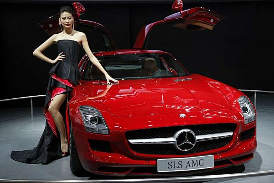 A model poses by a Mercedes-Benz SLS AMG vehicle during the opening day of the 8th China (Guangzhou) International Automobile Exhibition in Guangzhou, China, on Tuesday, Dec. 21, 2010. The Guangzhou Auto Show opened to the public today. Photographer: Qilai Shen/Bloomberg Photo: Qilai Shen, Bloomberg