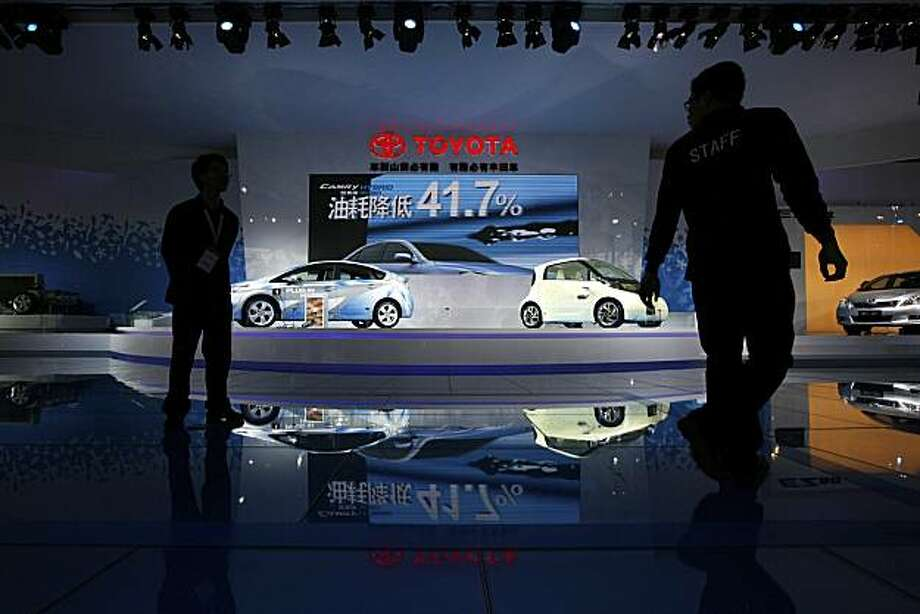 An FT-EV II concept electric car, right, and a Prius hybrid car are displayed at the Toyota booth at the Guangzhou 2010 Auto Show in China's southern city of Guangzhou Monday, Dec. 20, 2010. China's second major auto show kicked off Monday, capping a yearof record sales for the country's booming auto market even as it faces the prospect of slowing growth. Photo: Vincent Yu, AP