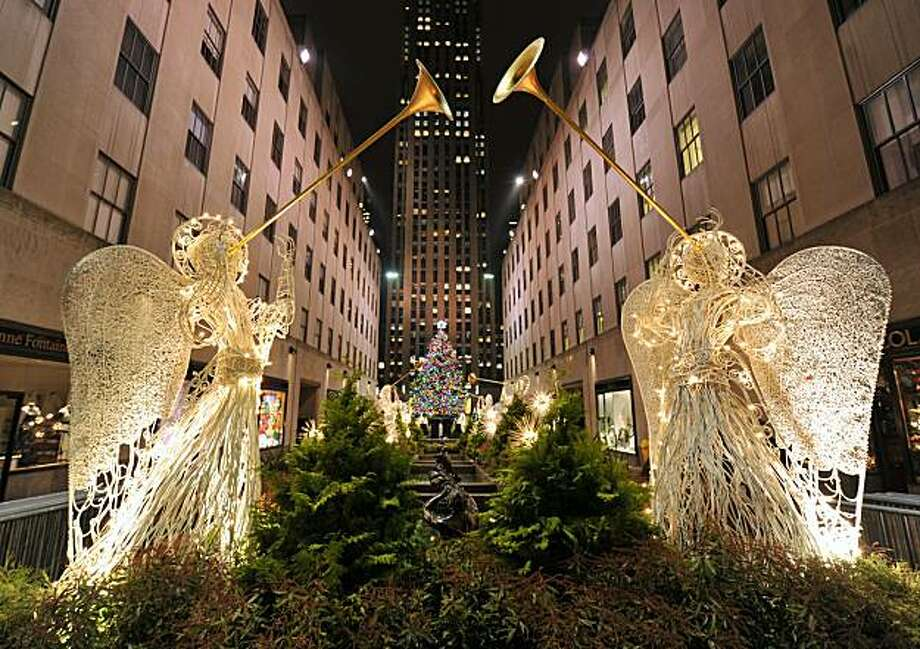 The Rockefeller Center Christmas Tree is lit on November 30, 2010 in New York. Originally from Mahopac, New York, the 12-ton, 74-foot Norway Spruce is adorned with 30,000 environmentally friendly LED lights on more than five miles of electrical wire, andtopped with a Swarovski crystal star. Photo: Stan Honda, AFP/Getty Images