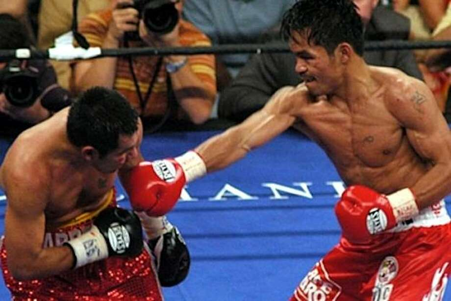 The Pac-Man, in all his glory, taking down Marco A. Barrera. Photo: Courtesy Of Manny Pacquiao