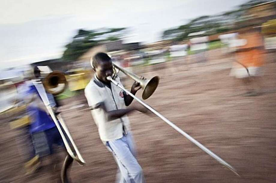 Members of the brass band rehearse marches in the schoolyard every evening. Photo: Eileen Roche, Photo Philanthropy