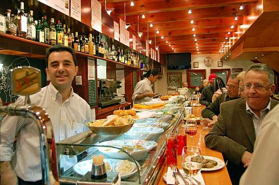 In Spain, sitting at the bar can be cheaper and give you the best view of the action ? and the food. Photo: Rick Steves