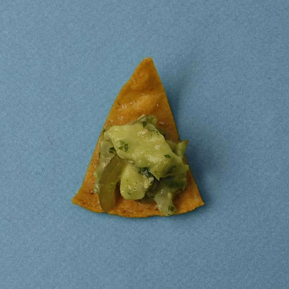 Homemade Tortilla Chips with Tomatillo Guacamole in San Francisco, Calif., on December 3, 2009. Food styled by Kalena Ross and Sarah Fritsche.