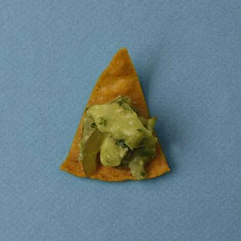 Homemade Tortilla Chips with Tomatillo Guacamole in San Francisco, Calif., on December 3, 2009. Food styled by Kalena Ross and Sarah Fritsche. Photo: Craig Lee Craig Lee, Special To The Chronicle Special