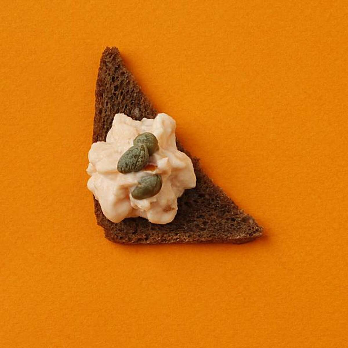 Smoked Salmon and Caper Spread on Pimpernickel in San Francisco, Calif., on December 3, 2009. Food styled by Kalena Ross and Sarah Fritsche.