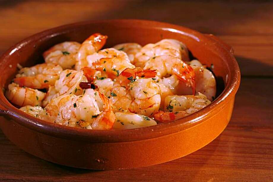 HOLIDAYENTERTAIN06_391_cl.JPG Photo on three 90-minute dinner party menus for holiday entertaining story by Janet Fletcher. Photo of garlic shrimp with sherry. Event on 11/30/06 in San Francisco.  photo by Craig Lee / The Chronicle Ran on: 12-06-2006 Photo: Photo By Craig Lee, SFC