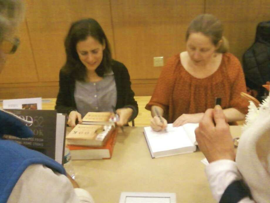 Amanda Hesser and Merrill Stubbs, authors of ìThe Food52 Cookbook,î sign books at the Darien Library. Photo by Thomas Michael Photo: Contributed Photo