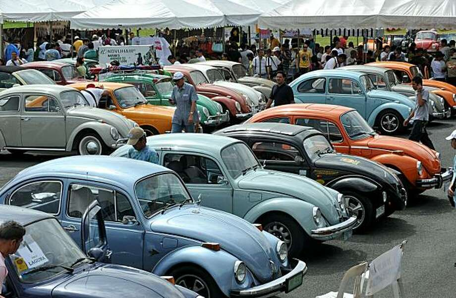 Vintage Volkswagen Beetle cars are parked on the naval parade grounds in Manila on December 5, 2010, during Volkswagen Day in the Philippines. Clubs all over the country gather every December for competition, get together with friends, family, selling parts and memorabilia. More than two hundred Vintage Volkswagen were displayed during the event. Photo: Jay Directo, AFP/Getty Images