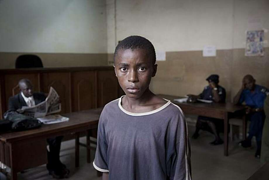 Abdul ready to attend his trial in a court in Freetown. Accused of having a portable radio. Photo: Fernando Moleres, Photo Philanthropy