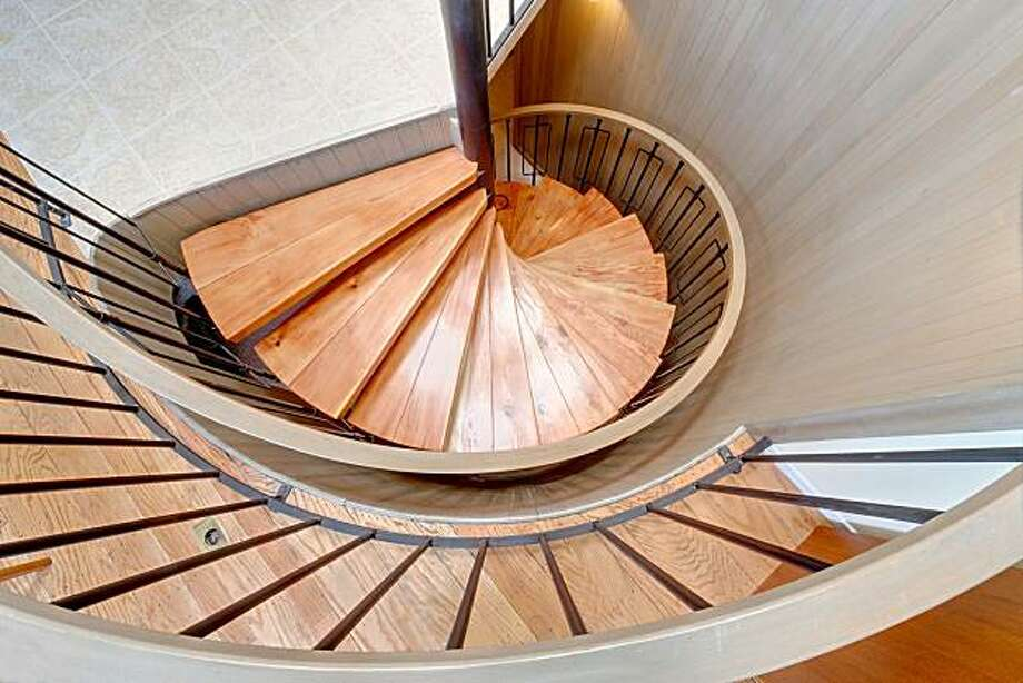 The home's spiral staircase opens at the top to the main living area. Photo: Courtesy Of Dan Friedman