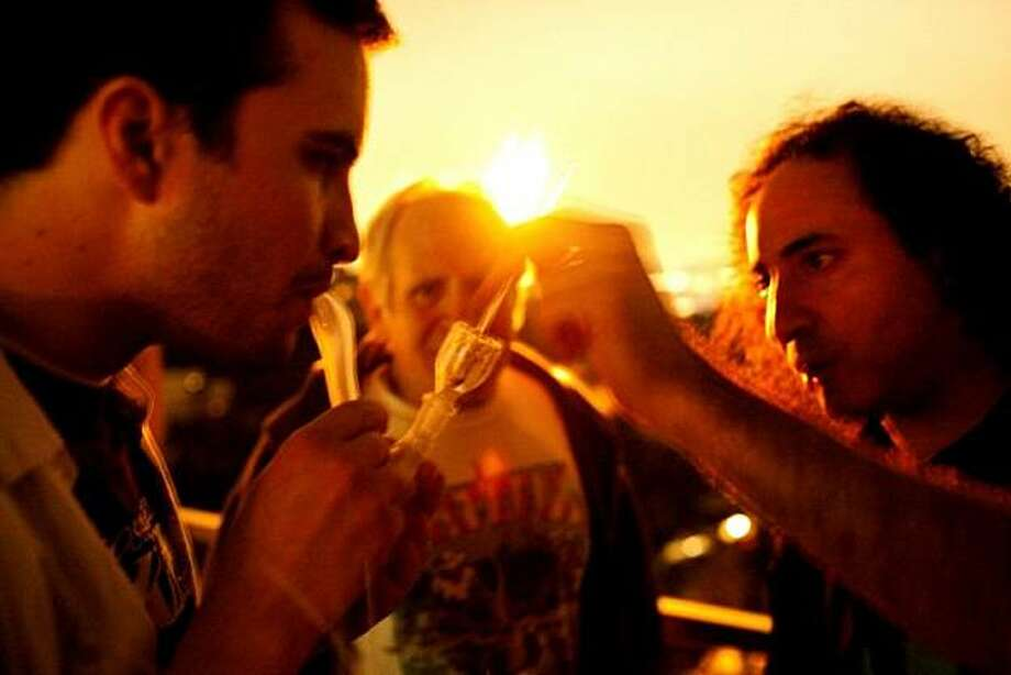 A young man smokes crack cocaine with two older men on Sunset Strip in West Hollywood, Calif. Photo: David Kasnic, Photo Philanthropy