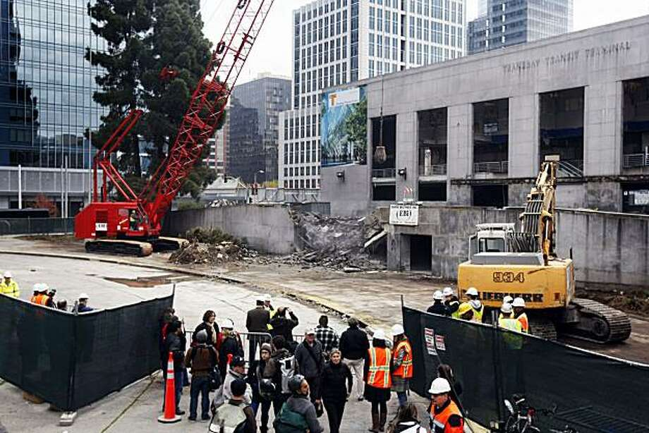 Construction personnel along with spectators looked on as the Big Red, crane, dropped its wrecking ball on the old Transbay Terminal building in San Francisco Friday Dec 3, 2010 Photo: Lance Iversen, The Chronicle