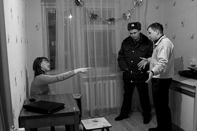 The police officer tries to resolve the family's violent incident. Photo: Anastasia Rudenko, Photo Philanthropy
