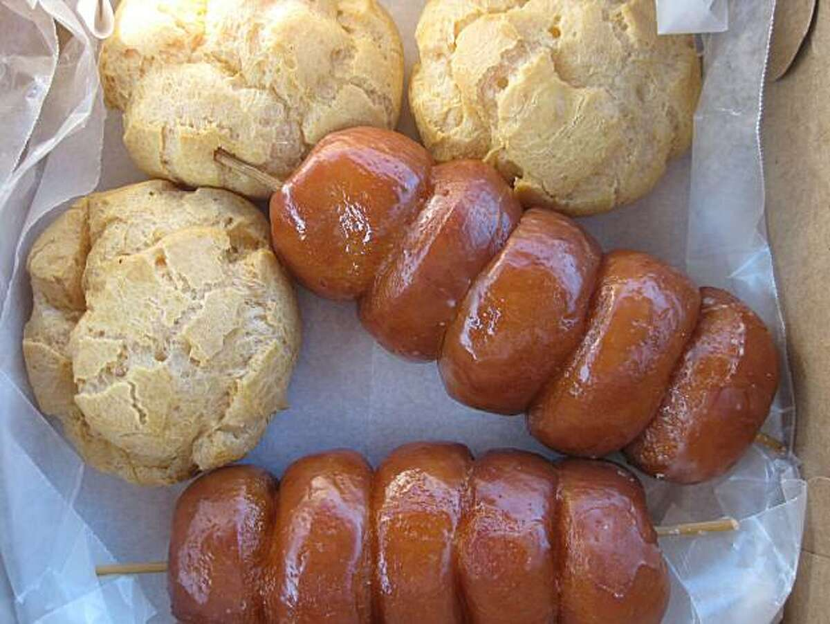 Coconut doughnuts on a stick and cream puffs, among other handmade treats, draw patrons to Komoda Store & Bakery in Makawao, Maui.