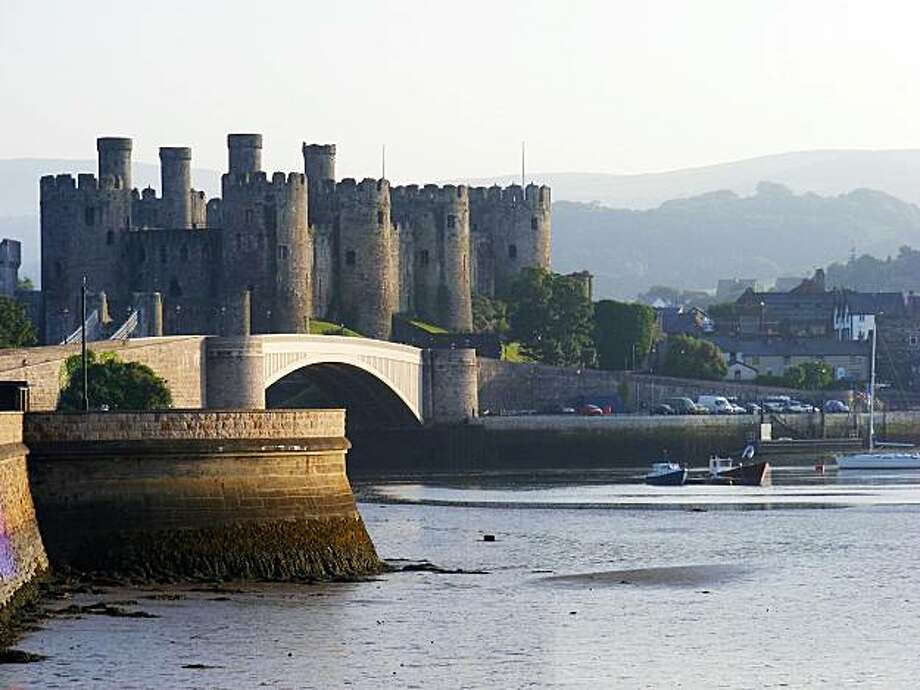 The round towers of Conwy Castle in North Wales rise dramatically over the banks of the River Gyffin. Photo: Gretchen Strauch