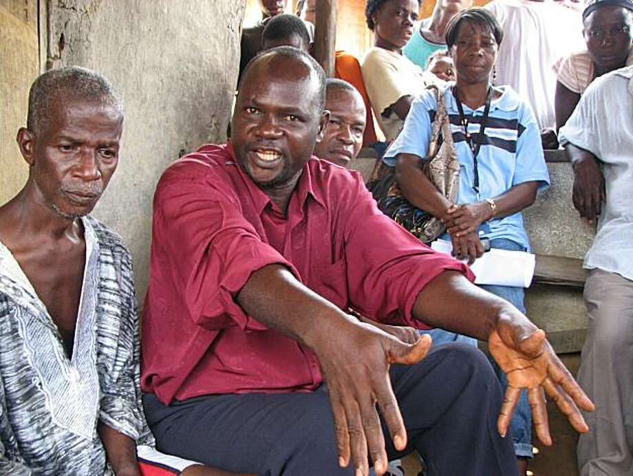 In the village of  Gbuyee, Augustus Karli explains a land dispute with a neighboring family. Photo: John Diaz, The Chronicle