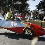 "The Red Bull Soapbox Derby. the ""Retro Rocket Racers"" entry driven by Justin Case takes the jump as the crowd cheers him on during race in San Francisco, Calif. on Oct. 18, 2008."