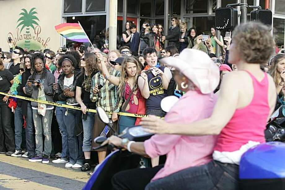 The crowd cheers as Dykes on Bikes leads off the 18th annual Dyke March up 16th Street from Dolores Park in San Francisco on Saturday. Photo: Kat Wade, Special To The Chronicle