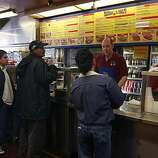 Customers line up to place their order at Taqueria El Farolito on Mission Street in San Francisco, Calif., on Thursday, June 10, 2010.