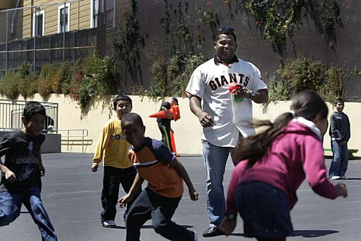 Giants' infielder Pablo Sandoval laughs while pitching to a group of children at at the Mission Education Center. Sandoval appeared at the Mission Education Center in the first of a series of Operation Panda events encouraging kids to be active in the summer in San Francisco, Calif. on Wednesday May 26, 2010.