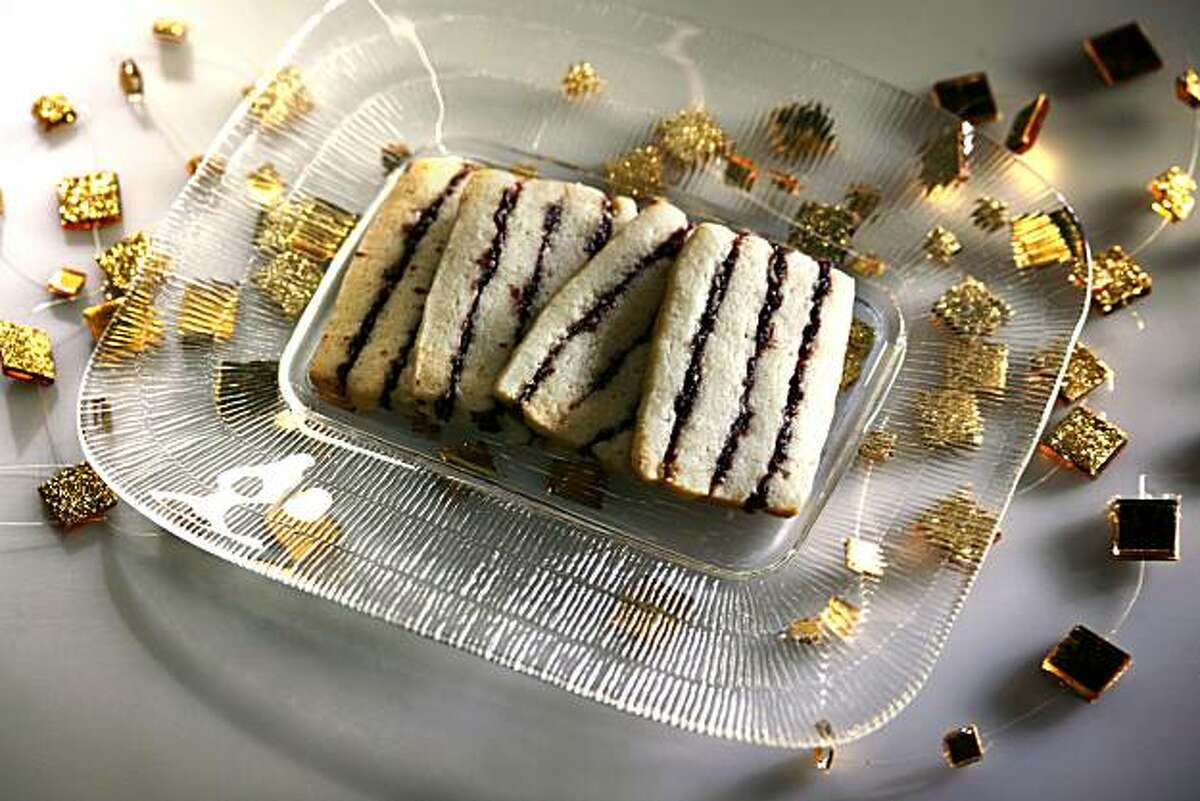 Chocolate Almond Ring Torte with a touch of gold leaf, top, and Cranberry Cherry Ribbon Cookies, above.