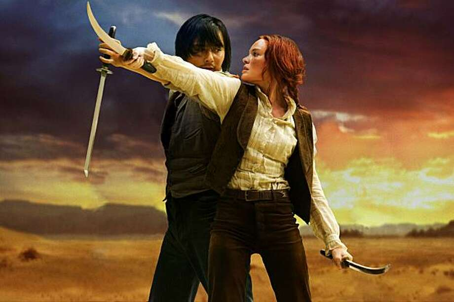 Lynne (Kate Bosworth) gets a lesson in swordsmanship from Yang (Jang Dong-Gun). And, um, other things. Photo: Courtesy Of Relativity Media