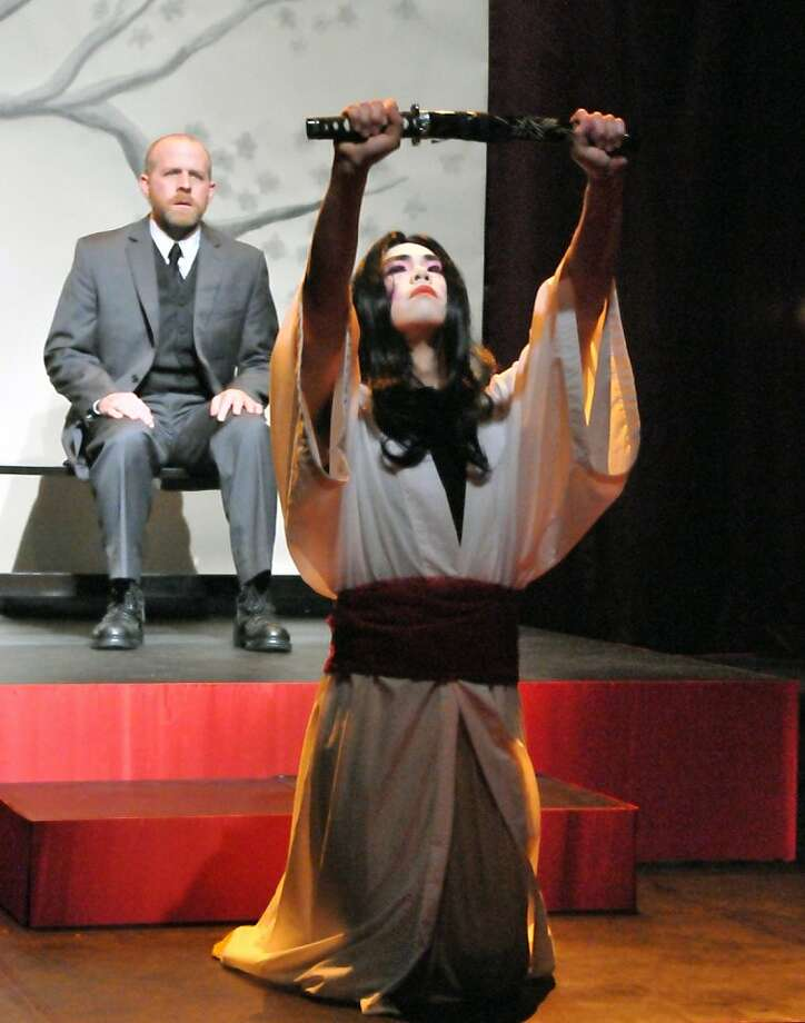 "Sean Fenton (front) as Song Liling and Rik Lopes as Rene Gallimard in Custom Made's production of ""M. Butterfly"" Photo: Jay Yamada"