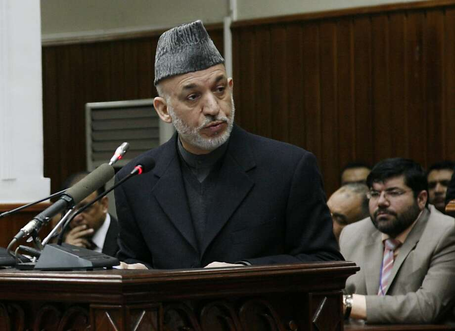 In this photo released by Presidential Palace, Afghan President Hamid Karzai speaks during the opening session of Afghan Parliament in Kabul, Afghanistan, Saturday, Feb. 20, 2010. Karzai said in a speech that NATO's efforts to prevent civilian deaths during its operations are not enough because innocent people keep dying, as the military alliance continued its offensive in a key Taliban stronghold. Photo: AP