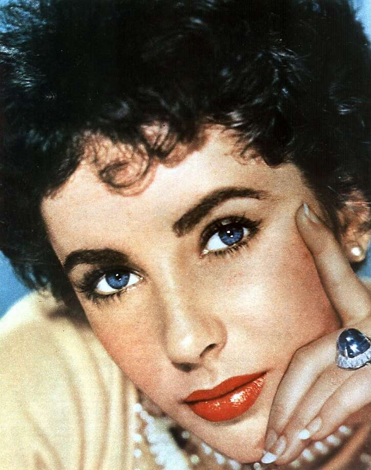 """(FILES) This undated file Hollywood handout photo shows actress Elizabeth Taylor.  Legendary Hollywood actress and violet-eyed beauty Elizabeth Taylor, who captured hearts in """"National Velvet"""" to launch a film career that spanned five decades, has died aged 79. Taylor had been in hospital in Los Angeles for six weeks with congestive heart failure, a condition with which she had struggled for some years, and had recently suffered complications, a family statement said on March 23, 2010. Photo: Ho, AFP/Getty Images"""