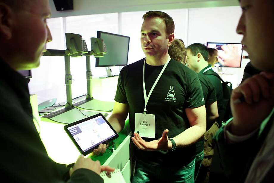Billy Rutledge (C) demonstrates the tablet friendly mobile Android 3.0, known as Honeycomb, operated by Motorola's tablet XOOM during the Android event on the main campus of Google in Mountain View on February 2, 2011 in California. AFP Photo / Kimihiro Hoshino (Photo credit should read KIMIHIRO HOSHINO/AFP/Getty Images) Photo: Kimihiro Hoshino, AFP/Getty Images