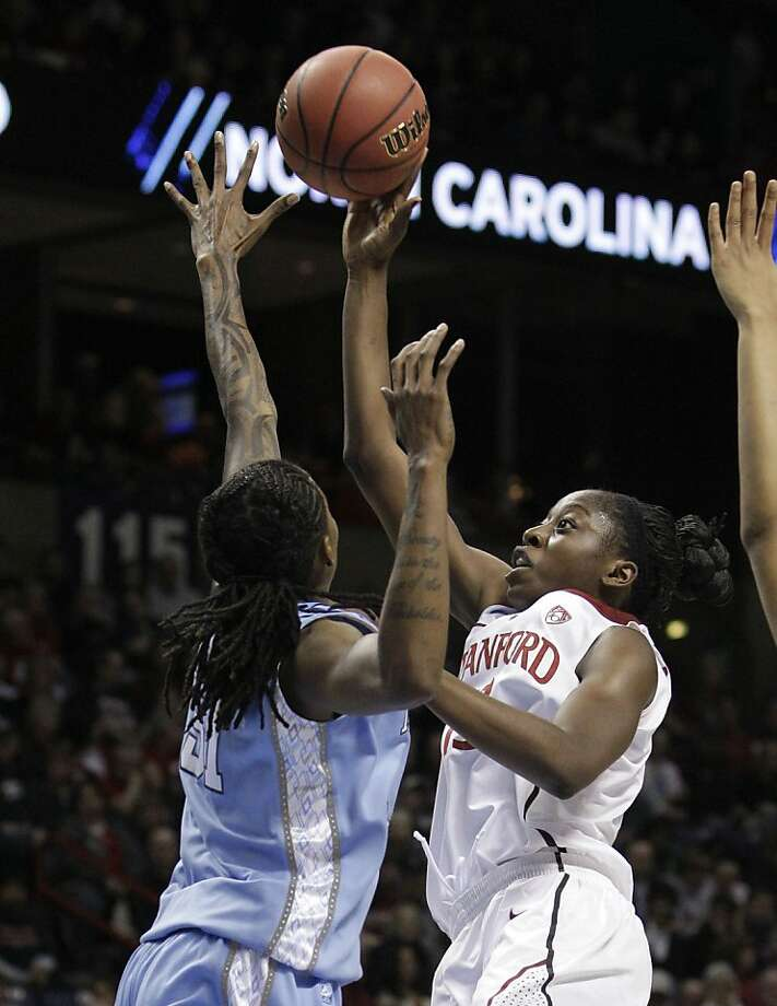 Stanford's Chiney Ogwumike, right, shoots over North Carolina's Jessica Breland in the first half of an NCAA women's college basketball tournament regional semifinal, Saturday, March 26, 2011, in Spokane, Wash. Photo: Elaine Thompson, AP