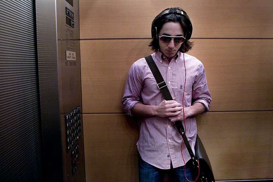 Two-time Cy Young award winning pitcher Tim Lincecum listens to music as he rides in the hotel elevator on his way to a game at Petco Park while on the road for a crucial series with the San Diego Padres in September during the 2010 season. Photo: Deanne Fitzmaurice