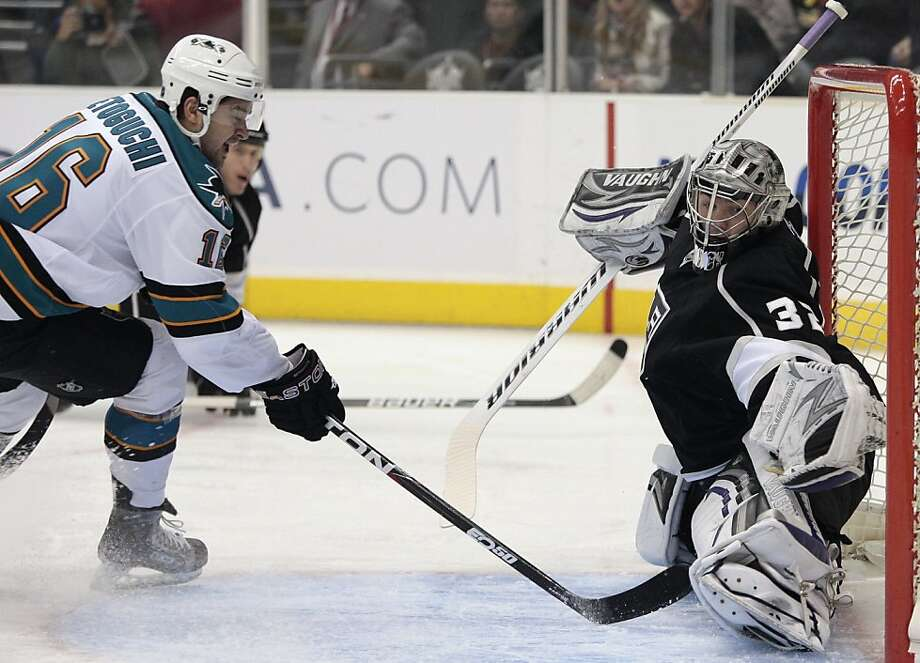 San Jose Sharks right wing Devin Setoguchi, left, tries to score on Los Angeles Kings goalie Jonathan Quick during the first period of an NHL hockey game Thursday, March 24, 2011, in Los Angeles. Photo: Jason Redmond, AP