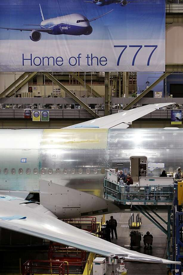 FILE - In this file photo taken Feb. 14, 2011, a Boeing 777 jet stands in a production line at the company's manufacturing plant, in Everett, Wash. Boeing Co. said Thursday, March 24, 2011, cargo hauler FedEx has ordered four more of its 777s. Photo: Elaine Thompson, AP