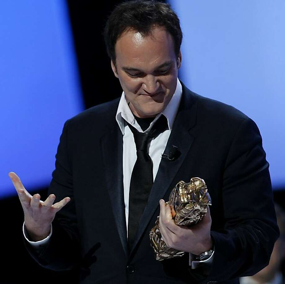 U.S director Quentin Tarantino speaks after he received a Cesar award of honor  during the 36th Cesar Awards ceremony in Paris, Friday, Feb. 25, 2011. Photo: Jacques Brinon, AP