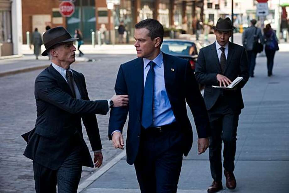"(L to R) Bureau supervisor Richardson (JOHN SLATTERY) threatens David Norris (MATT DAMON) in the romantic thriller ""The Adjustment Bureau"". In the film, Damon plays a man who glimpses the future planned for him and realizes he wants something else. To get it, he must pursue the only woman he's ever loved and defy the agents of Fate--a mysterious group of men exerting control over their lives. Photo: Andrew Schwartz, Universal Pictures"