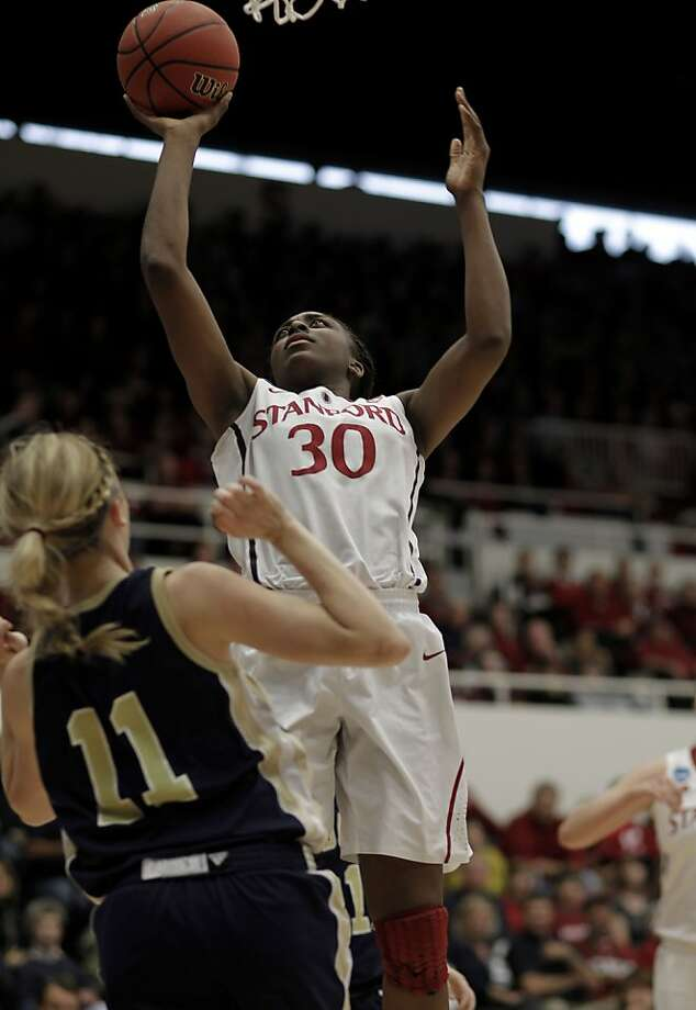 Stanford's Nnemkadi Ogwumike (30) fires a shot over UC Davis' Paige Mintun (11) as the Cardinal play the UC Davis Aggies in the first round of the NCAA Tournament on Saturday at Maples Pavilion in Palo Alto. Photo: Michael Macor, The Chronicle